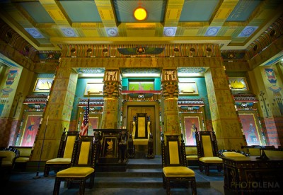 The winged sun suspended over the Worshipful Master's throne in the Egyptian room of a Masonic Temple Grand Lodge.jpg
